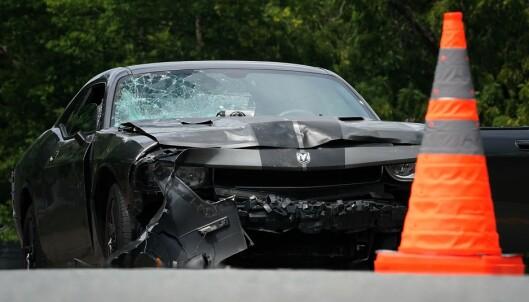<strong>KJØRTE INN I FOLKMENGDE:</strong> Føreren av denne bilen er arrestert, ifølge AP. Foto: AFP / NTB Scanpix