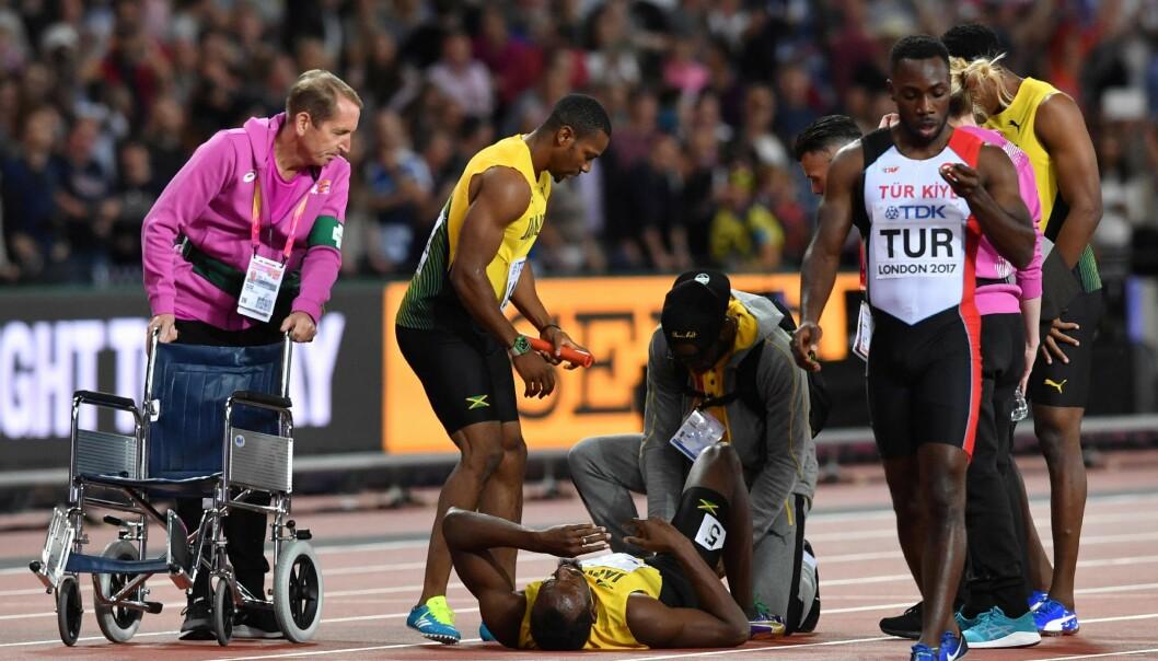 <strong>RULLESTOL:</strong> Han er vant til å bli båret på gullstol, i dag fikk Usain Bolt tilbud om rullestol. Foto: NTB Scanpix