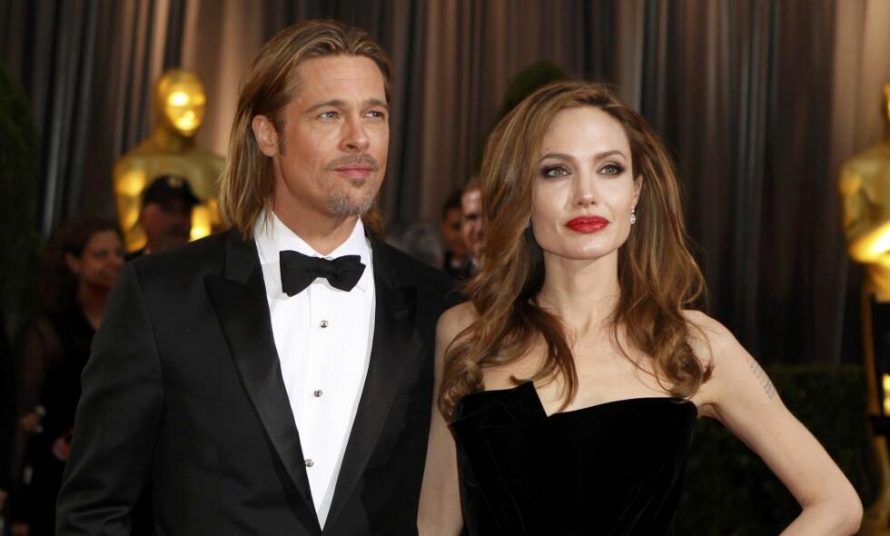 TAPTE: Brad Pitt og Angelina Jolie ble saksøkt for 600 000 dollar. Søndag ble det kjent at dem har tapt. Foto: Reuters