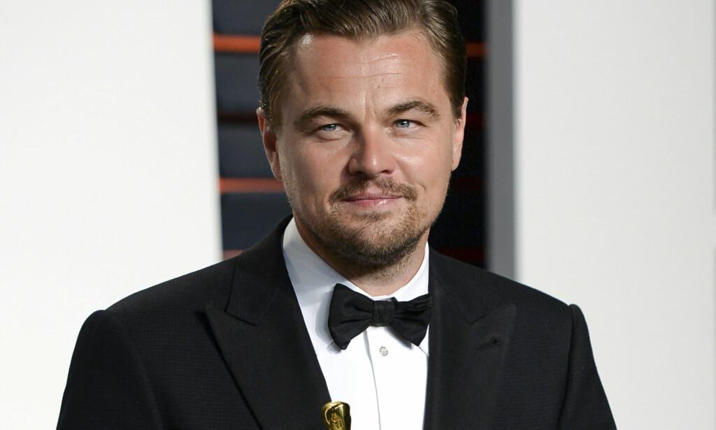 ÅPNER LOMMEBOKA: Leonardo DiCaprio er blant dem som den siste uka har vist medmenneskelighet med ofrene i Texas og Louisiana. Foto: NTB scanpix