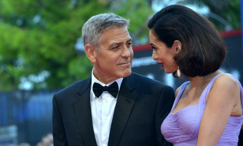 TVILLINGER: George og Amal Clooney trives godt i rollen som foreldre, men innrømmer at det er slitsomt å ha tvillinger. Foto: Pa Photos