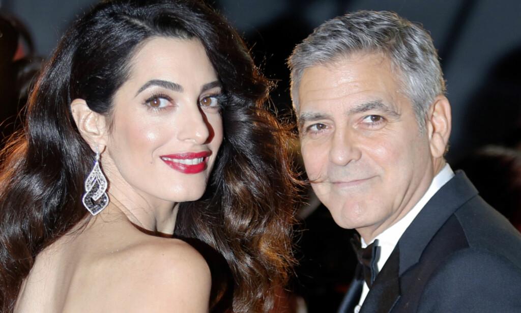 TVILLINGER: George og Amal Clooney trives godt i rollen som foreldre, men innrømmer at det er slitsomt å ha tvillinger. Foto: NTB Scanpix