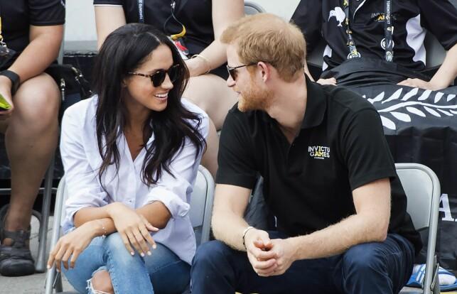 KJÆRLIGHETEN BLOMSTRER: Skuespiller Meghan Markle og prins Harry klarer ikke å skjule sin stormforelskelse. Her avbildet i Canada under Invictus Games i september. Foto: NTB scanpix
