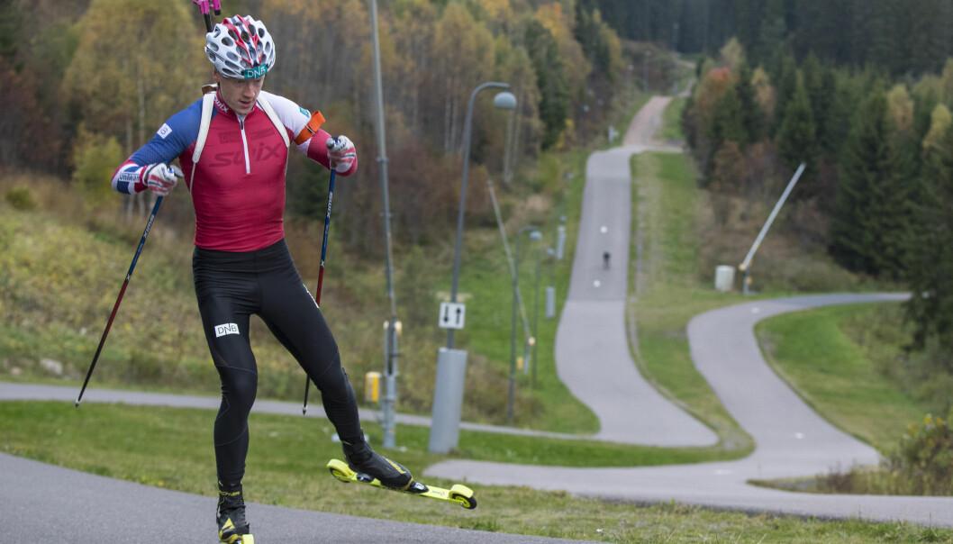 <strong>TROR PÅ HJELMESET:</strong> Johannes Thingnes Bø har stor tro på Odd-Bjørn Hjelmeset som ny skiskyttersjef. Foto: Vidar Ruud / NTB scanpix
