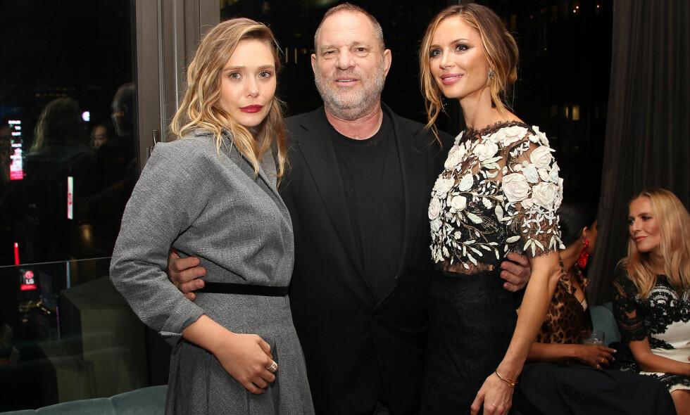 I HARDT VÆR: Hollywood-produsent Harvey Weinstein. Her er han avbildet sammen med skuespiller Elizabeth Olsen og kona Georgina Chapman. Foto: Kristina Bumphrey/ StarPix/ REX/Shutterstock / NTB scanpix