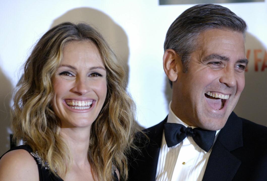 Julia Roberts og George Clooney backstage under den 21. American Cinematheque Award gala i 2006.