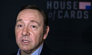 """(FILES): This file photo taken on February 23, 2016 shows actor Kevin Spacey arriving for  the season 4 premiere screening of the Netflix show """"House of Cards"""" in Washington, DC. Kevin Spacey came out as gay early Monday, October 30, 2017 and apologized to actor Anthony Rapp, who accused the Hollywood star of making a sexual advance on him at a 1986 party when he was only 14 years old. Spacey's announcement, posted to his Twitter account at midnight, came after Rapp -- best known for being part of the original cast of Broadway hit """"Rent"""" -- made the accusation in an interview with Buzzfeed News. / AFP PHOTO / Nicholas Kamm"""