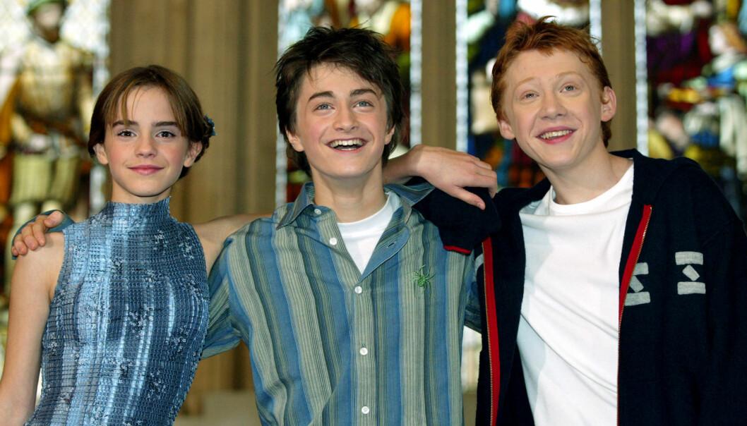 <strong>SEES SVÆRT SJELDEN:</strong> Over en periode på ti år tilbrakte Rupert Grint, Daniel Radcliffe og Emma Watson utallige timer sammen som en del av «Harry Potter»-filmatiseringene. I et nytt intervju sier Grint at skuespillerne har lite kontakt i dag. Her er trioen avbildet i 2002. Foto: Reuters/ NTB scanpix