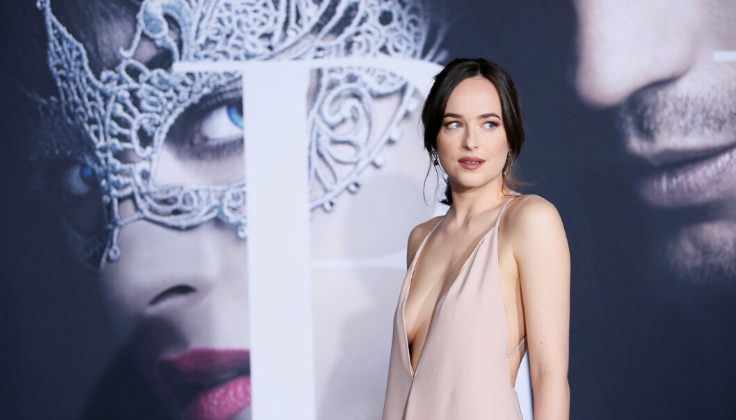 DAKOTA JOHNSON: Fifty Shades-stjernen er på turné for å promotere sin nye film - og hun stråler! FOTO: NTB Scanpix