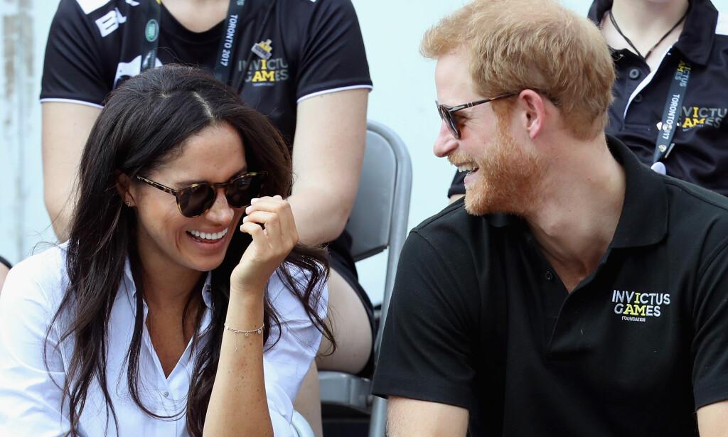 SIER OPP JOBBEN: Us Weekly skriver på sine nettsider at de har fått bekreftet at prins Harrys kjæreste Meghan Markle har sagt opp jobben sin i TV-serien «Suits». Her er de to sammen under idrettsarrangementet Invictus Games. Foto: NTB Scanpix