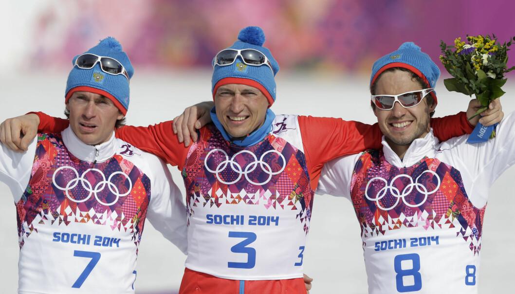 <strong>UTESTENGT:</strong> Maxim Vylegzjanin og Alexander Legkov er begge utestengt fra OL på livstid. Her sammen med Ilia Tsjernusov. Foto: AP Photo/Matthias Schrader