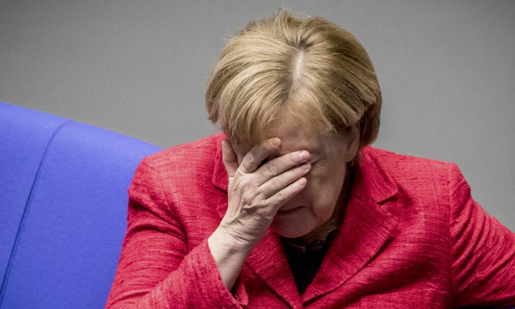 <strong>ET BILDE SIER MER:</strong> ...enn 1000 ord. Angela Merkel i forbundsdagen i går, der hun ikke har klart å stable på plass et flertall. Foto: AP / NTB Scanpix