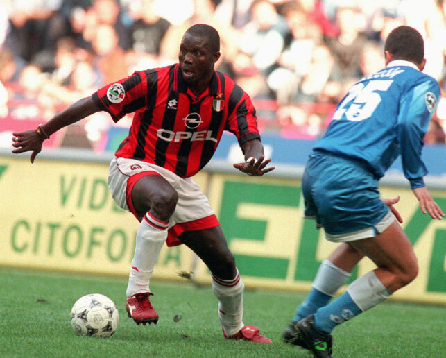 ** FILE ** Milan's forward George Weah, left, dribbles past Napoli defender Mirko Taccola during their Italian Serie A soccer match in Milan Sunday, Oct. 20, 1996. African soccer legend Weah is one of the leading candidates running in the Oct. 11 elections in Liberia, the West African country's first elections since civil war ended two-years ago. (AP Photo/Carlo Fumagalli)