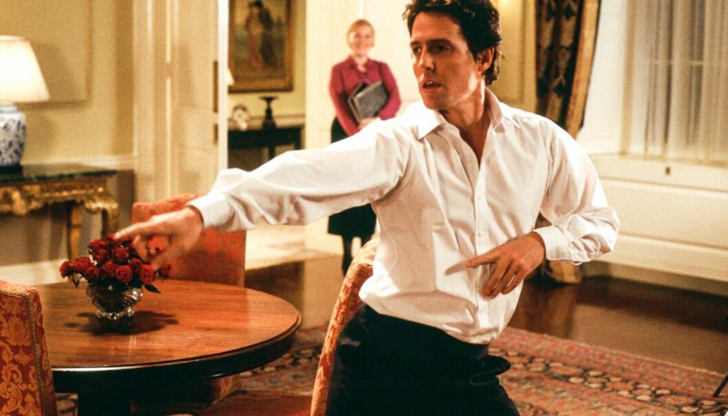 VILLE IKKE DANSE: Hugh Grant ville i utgangspunktet ikke danse, men da han til slutt begynte ble han så revet med at det nesten ble for mye. Foto: Love Actually