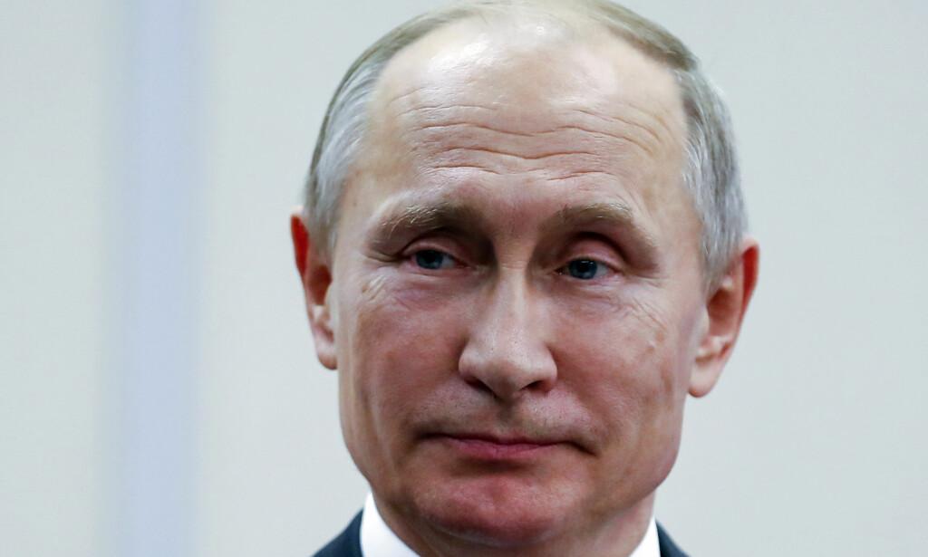 REGISTRERT SOM AGENTER: Vladimir Putin signerte i forrige måned en ny lov som gjør at internasjonale medier kan bli registrert som utenlandske agenter. Foto: AP / NTB scanpix