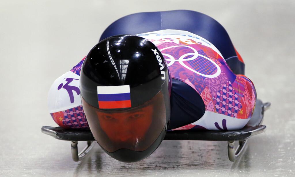 AVSLØRT: Den russiske skeletonstjernen Alexander Tretiakov er en av Sotsji-heltene som må gi fra seg gullmedaljen. I går mistet russisk toppidrett all ære. FOTO: Reuters/Fabrizio Bensch.