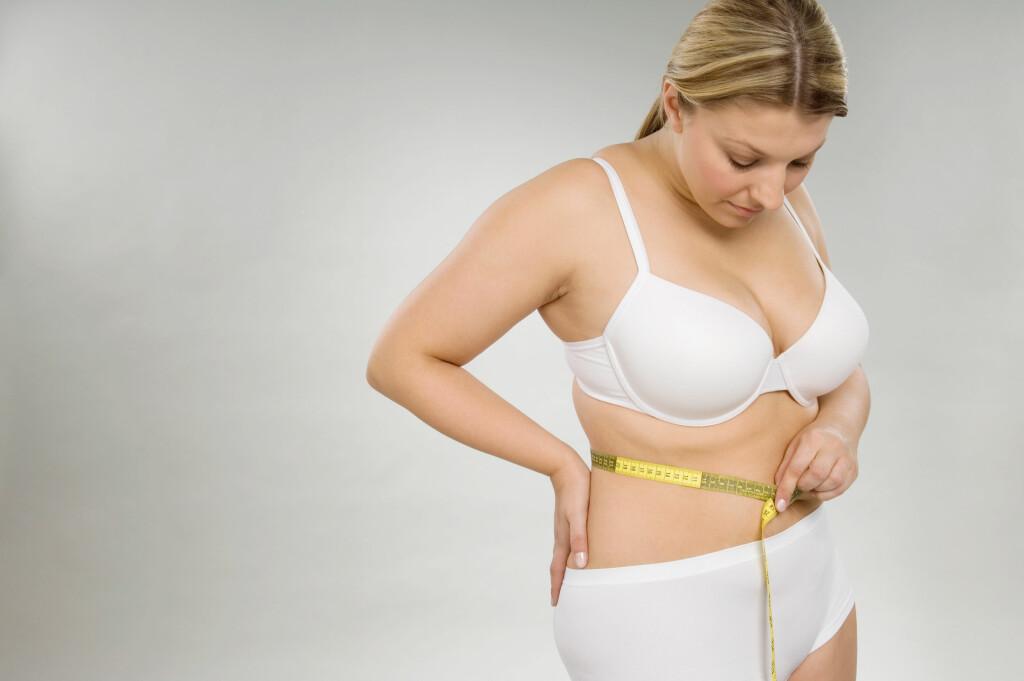 NÅR VEIER DU FOR MYE? En BMI (kroppsmasseindeks) på over 30 klassifiseres som fedme, over 25 som overvekt. Men du bør også sjekke midjemålet. Foto: NTB Scanpix