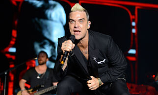 Singer Robbie Williams performs on stage during a concert to celebrate the tenth anniversary of the reign of Albert II, in front of the Monaco Palace in Monaco, Sunday, July 12, 2015. (Jean Pierre Amet/Pool via AP)