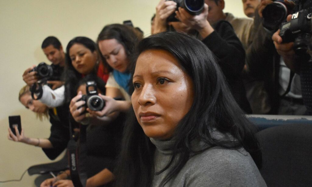 "Teodora del Carmen Vasquez attends a hearing at the Isidro Menendez Judicial Center, to review her 2008 sentence -handed down under draconian anti-abortion laws after suffering a miscarriage- in San Salvador on December 13, 2017. Salvadorean justice is reviewing on Wednesday, the 30-year prison term, given to Vasquez, after she was found guilty of ""aggravated homicide"" for a stillbirth in her ninth month of pregnancy. Her lawyer and rights groups call for her to be freed. / AFP PHOTO / OSCAR RIVERA"