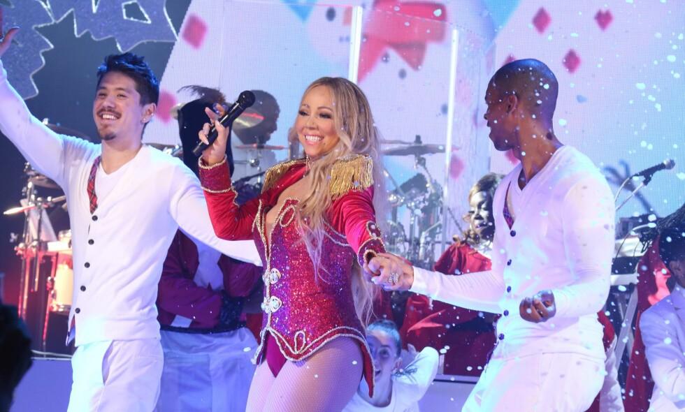 TJENER GODT: Mariah Carey tjener seg søkkrik på julelåta «All I Want For Christmas Is You». FOTO: NTB Scanpix