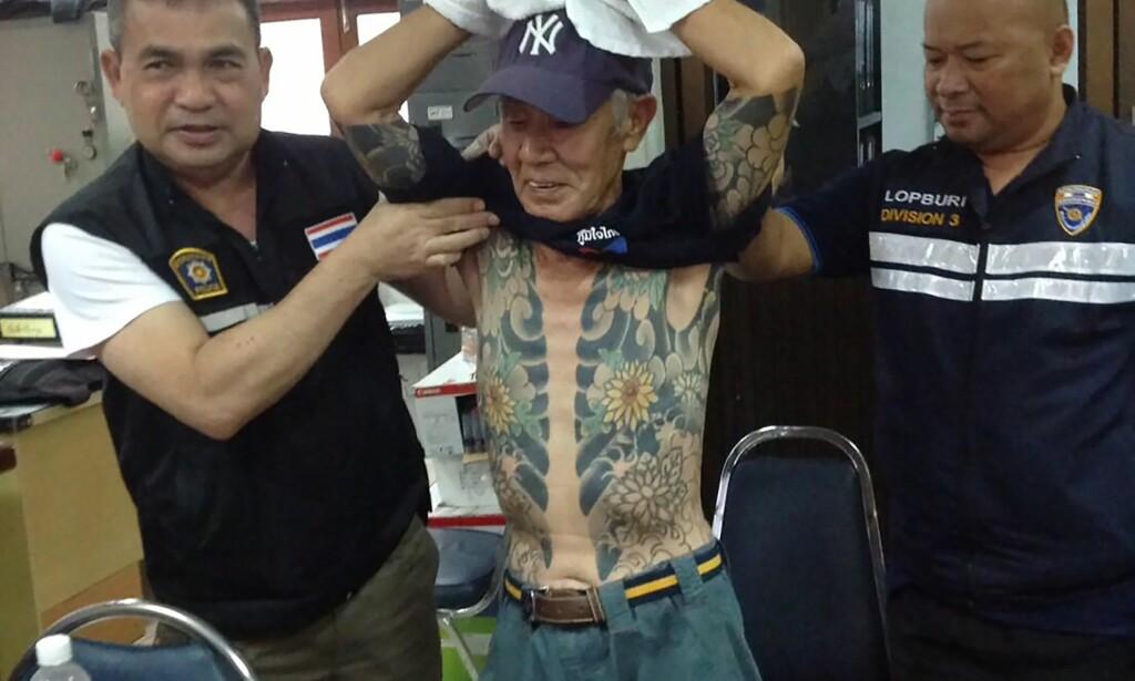 MERKET FOR LIVET: Tatoveringer er som kjent ikke noe man så lett kvitter seg med, spesielt ikke når man har dem over hele kroppen. For Shigeharu Shirai ble kroppskunsten hans bane, da han ble arrestert etter at et bilde av ham gikk viralt. Foto: AFP PHOTO / THAI ROYAL POLICE / Handout / NTB scanpix
