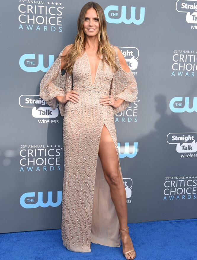 <strong>GLITTER OG GLAM:</strong> Heidi Klum hadde valgt både høy splitt, glitter og diamanter på kjolen. Foto: NTB Scanpix