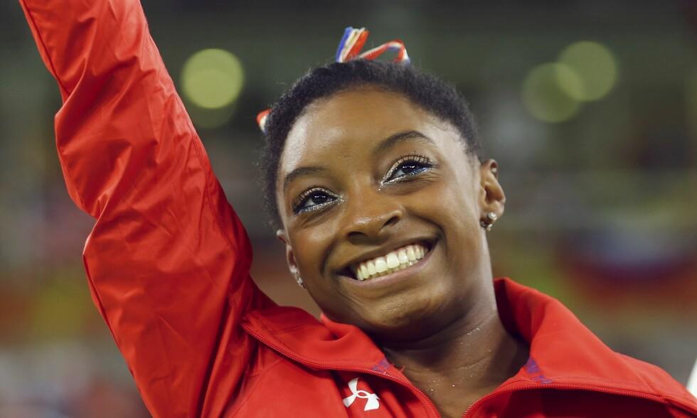 STÅR FRAM: Simone Biles har ti VM-gull, fire OL-gull og én vond historie. Foto: NTB Scanpix