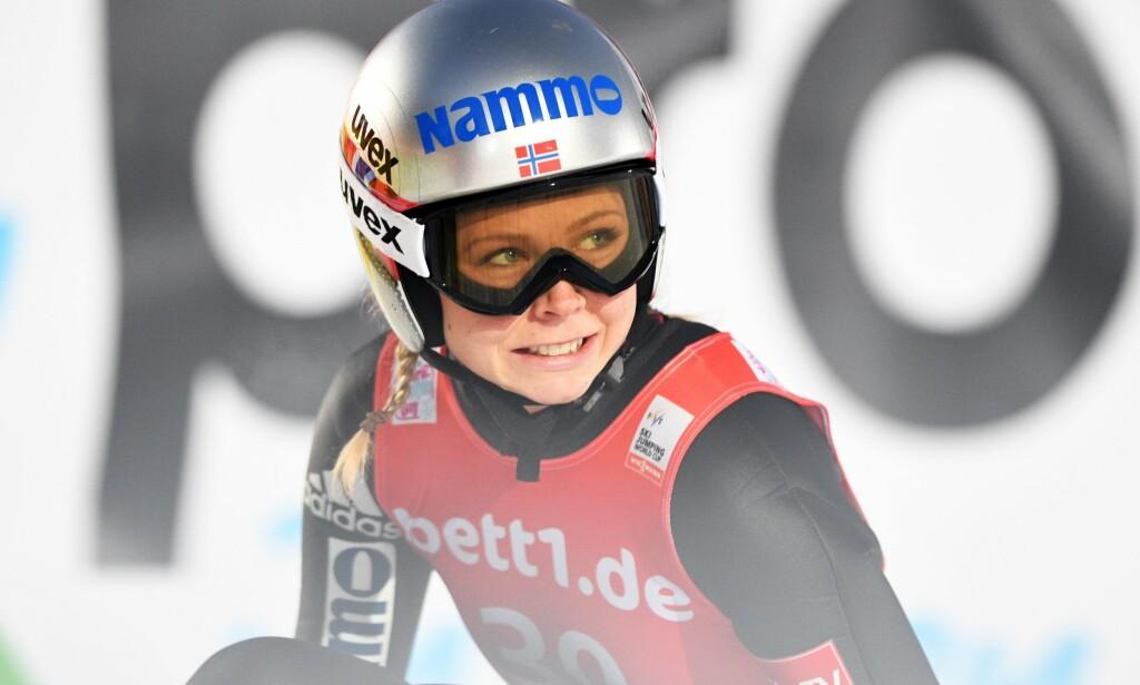 NÅDDE IKKE HELT OPP: Maren Lundby hoppet ikke opp mot sitt beste i kvalifiseringen fredag. Foto: AFP PHOTO/Felix Kästle