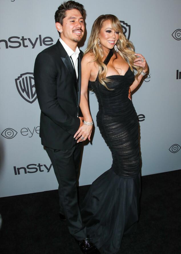 VISTE FIGUREN: Brian Tanaka og Mariah Carey på festen til InStyle og Warner Bros etter Golden Globe i starten av januar. Foto: NTB scanpix