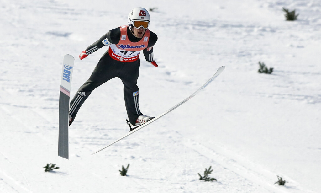 Daniel Andre Tande of Norway soars through the air during his first competition jump at the Ski Flying World Championships in Oberstdorf, Germany, Friday, Jan. 19, 2018. (AP Photo/Matthias Schrader)