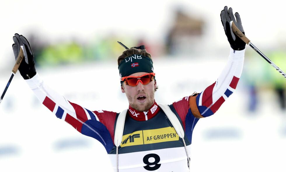 PÅ PALLEN: Erlend Bjøntegaard havnet på pallen for første gang i verdenscupen da Martin Fourcade vant. Foto: Berit Roald / NTB scanpix