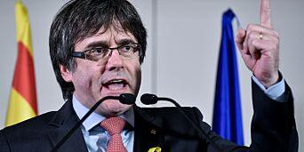 image: Catalonias separatistleder trosser arrestordre. Har landet i København