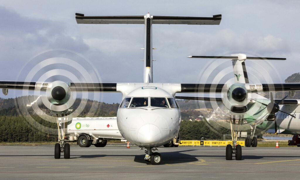 INNGÅR NORWEGIAN-SAMARBEID: Widerøe. Her representert ved et av selskapets fly på Værnes lufthavn. Foto: Gorm Kallestad / NTB scanpix