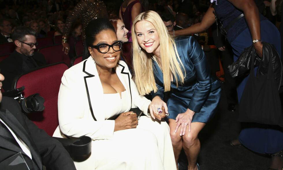 FOR MYE ARMER OG BEIN: Oprah Winfrey og Reese Witherspoon er begge å se på forsida av Vanity Fairs siste Hollywood-utgave. Med litt for mange kroppsdeler, vel å merke. Her fra Emmy-utdelingen i fjor. John Salangsang / Invision / NTB Scanpix
