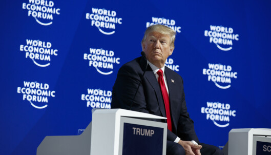 President Donald Trump listens as he is introduced to deliver a speech to the World Economic Forum, Friday, Jan. 26, 2018, in Davos. (AP Photo/Evan Vucci)
