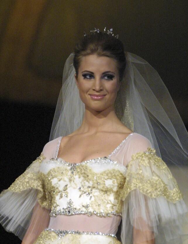 MODELL: Eva Sannum avbildet under et Nora Farah-show, der hun viste fram brudekjoler. Foto: All Over Press/ Se og Hør