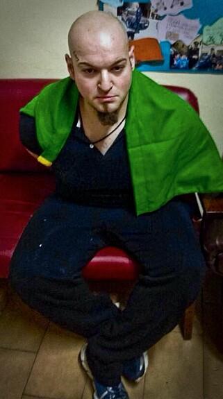 TATT HÅND OM: Luca Traini fotografert etter pågripelsen. Foto: NTB scanpix