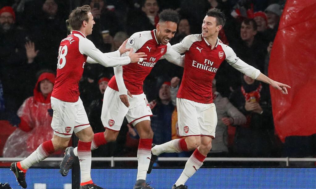 HERJER: Pierre-Emerick Aubameyang (i midten) herjer i Arsenal-debuten. Foto: REUTERS/David Klein