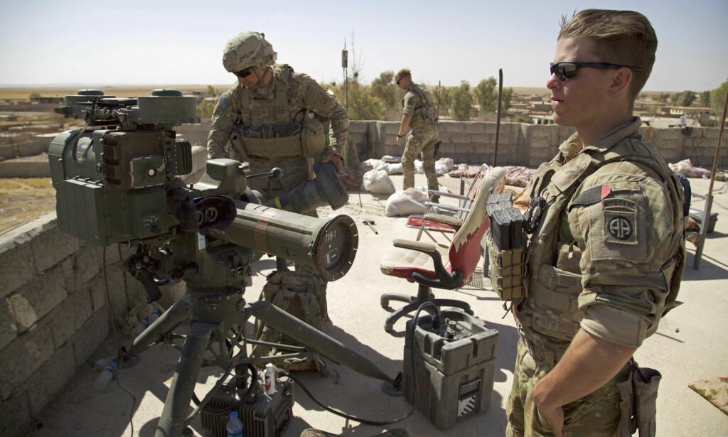 UT AV IRAK: USA har begynt å trekke styrker ut av Irak, ifølge irakiske myndigheter. Foto: AP Photo/Balint Szlanko, File)