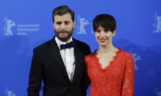 HAR IKKE SETT FILMENE: Dornan har innrømmet at hans kone Amelia Warner ikke har sett noen av filmene. Foto: AP Photo/Markus Schreiber