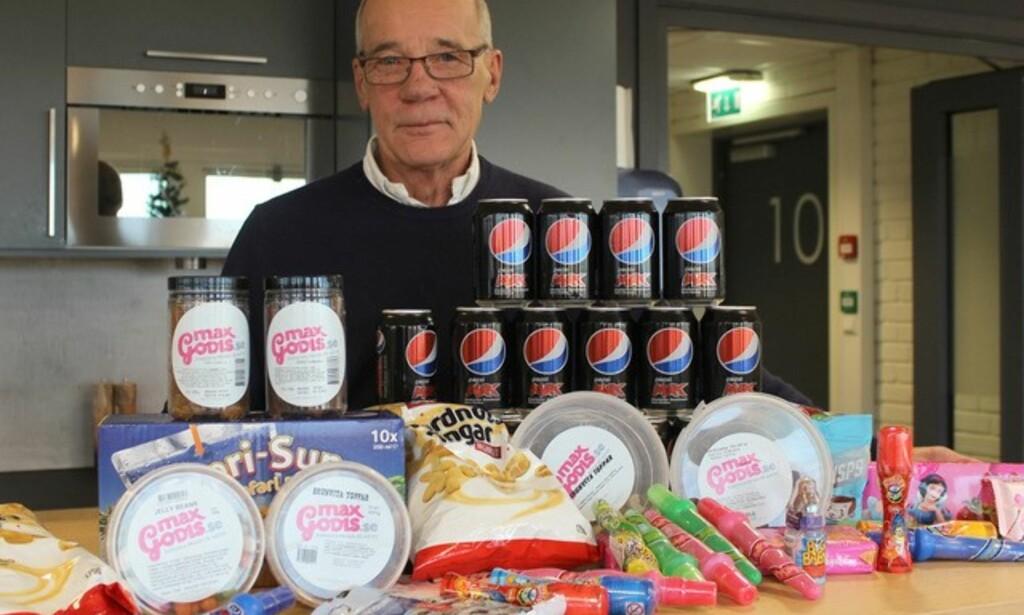 FORNØYD: Administrerende direktør Morten Hansson i Maxgodis selger som aldri før etter at sukkeravgiften ble innført og prisene gikk opp i Norge. Foto: Maxgodis