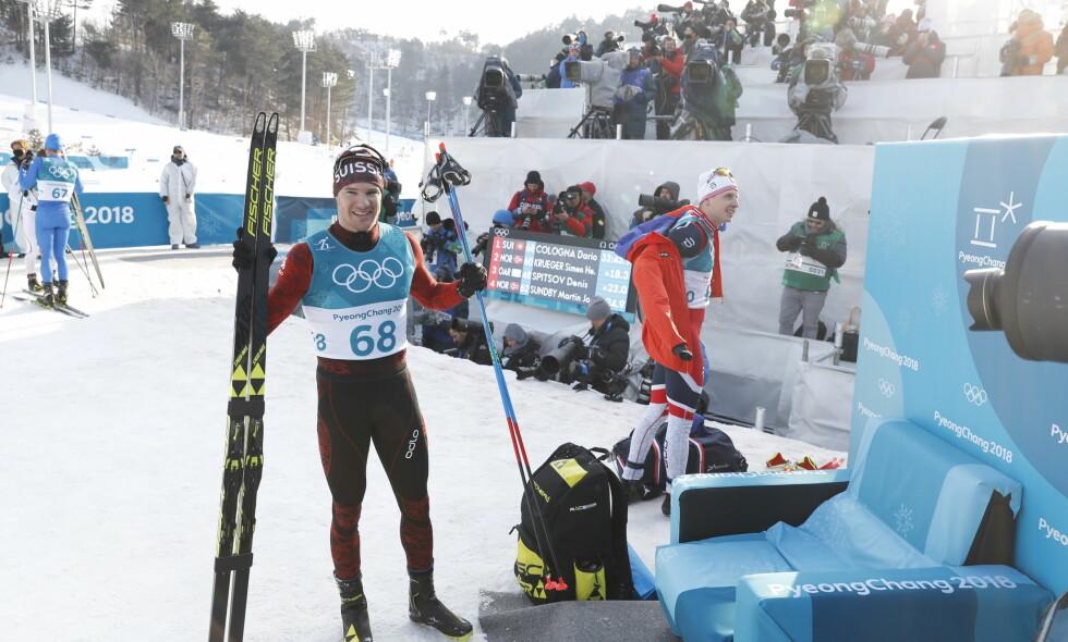GULL- OG SØLVVINNEREN: Dario Cologna vant sin tredje 15 kilometer i OL. Simen Hegstad Krüger tok sølv. Foto: Bjørn Langsem/Dagbladet