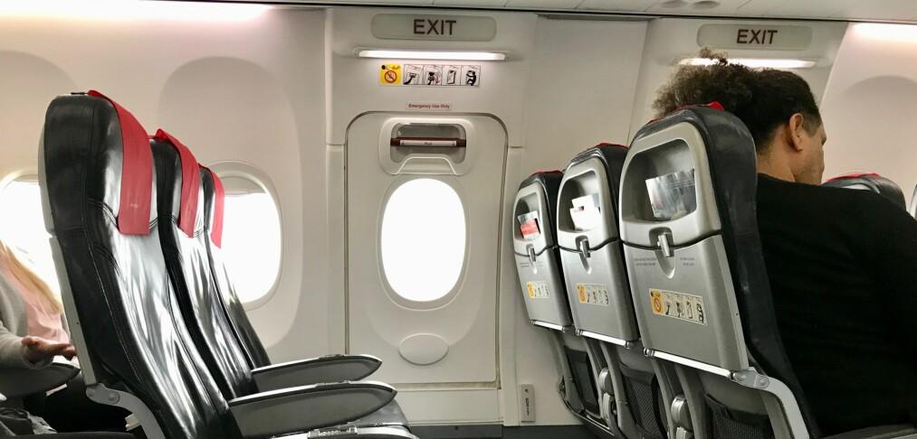 Passasjer prøvde å åpne flydør