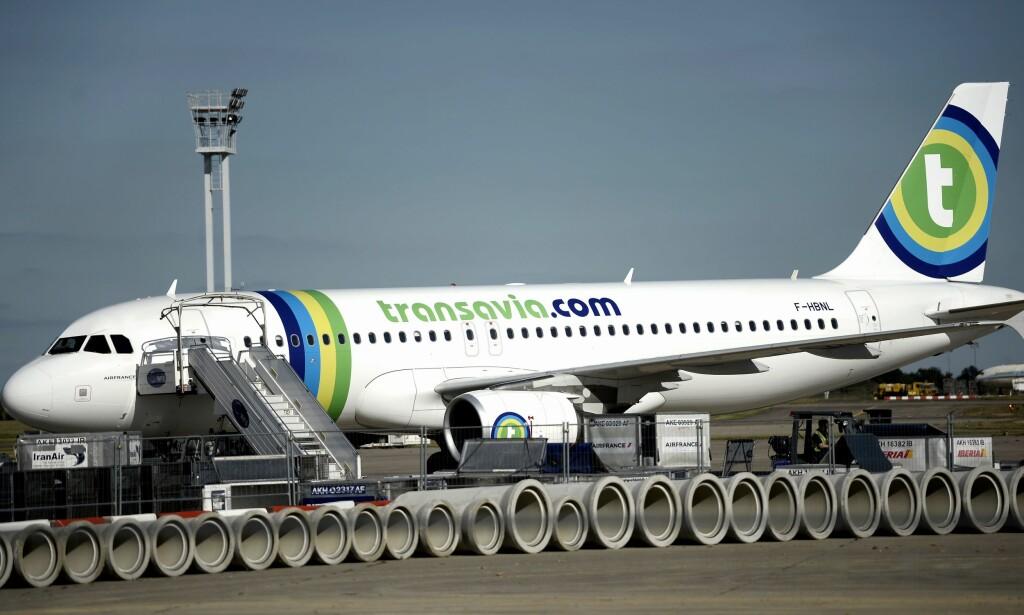 MÅTTE NØDLANDE: Et Transavia-fly på vei til Amsterdam så seg nødt til å lande i Wien da det brøt ut slagsmål om bord. Slåsskampen skyldtes at en passasjer nektet å slutte å prompe. Arkivfoto: NTB / Scanpix