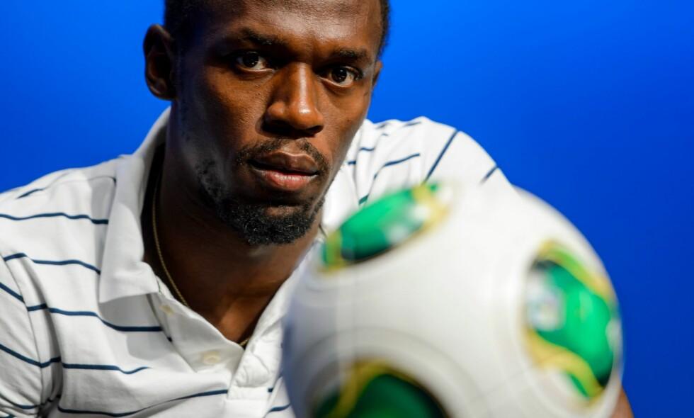 FOTBALLSPILLER: Usain Bolt skal prøve seg som fotballspiller og har signert for en klubb. Mye tyder på at det er Mamelodi Sundowns, men foreløpig er ingenting bekreftet. Foto: AFP PHOTO / Fabrice COFFRINI