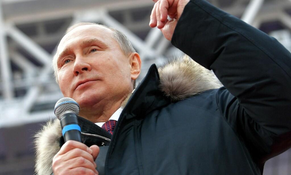 UTLEVERER IKKE: Russlands president Vladimir Putin forteller søndag at landet aldri vil utlevere de 13 russerne som er mistenkt for å ha påvirket det amerikanske valget i 2016. Foto: Alexei Druzhinin/ AP/ NTB scanpix