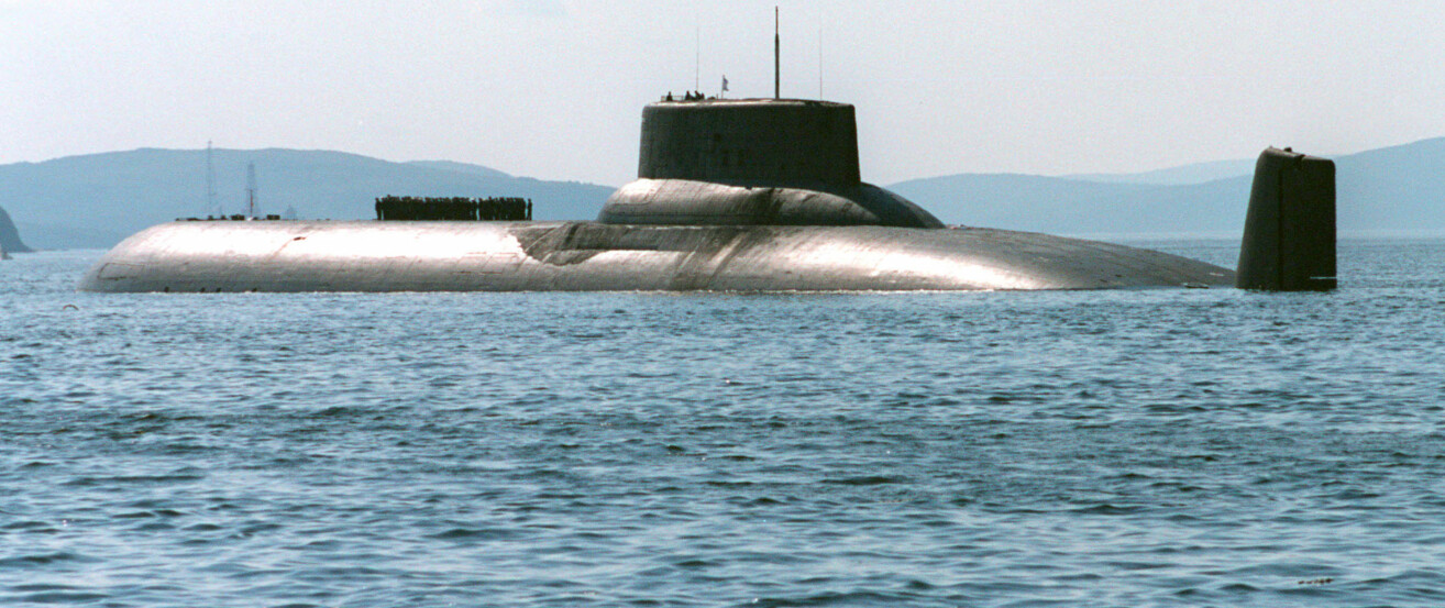 ** FILE ** Arkhangelsk, one of Russia's largest Typhoon-type Soviet-built nuclear submarines, heaves ahead in the Barents Sea near Severomorsk, Russia in this July 27, 2003 file picture. President Vladimir Putin on Tuesday went out to the Barents Sea on board Arkhangelsk to observe a massive military exercise set to involve numerous missile launches and flights of strategic bombers. (AP Photo/ file)
