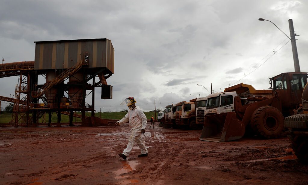 A worker walks at an interdicted area which is part of DRS2 bauxite residue deposit of the alumina refinery Alunorte, owned by Norwegian company Norsk Hydro ASA, in Barcarena, Para state, northern Brazil March 5, 2018. REUTERS/Ricardo Moraes