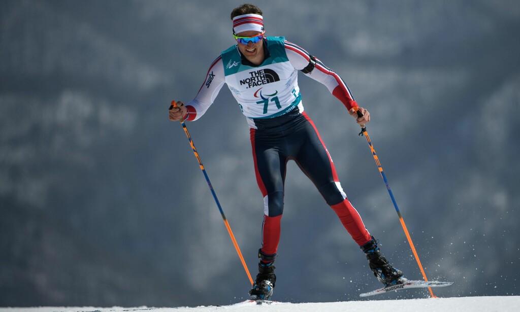 BRONSE: Nils-Erik Ulset sikret seg bronse i skiskyting under Paralympics i Pyeongchang. Foto: AFP PHOTO / OIS/IOC / Thomas LOVELOCK