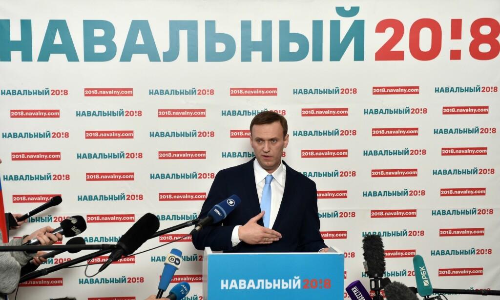 VALG: Urnene helst øst i Russland ble åpnet lørdag kveld norsk tid. En som de ikke kan stemme på er denne karen, Aleksej Navalnyj. Han ble lenge sett på som Putins fiende i lang tid, helt til han ble nektet å stille som presidentkandidat. Foto: NTB scanpix